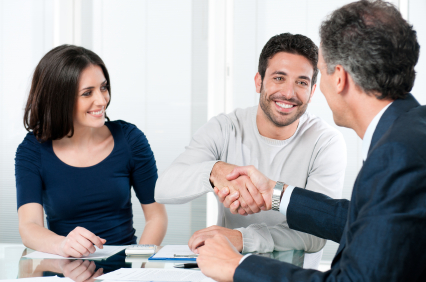 Couple getting advice on Adverse Mortgages
